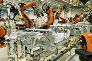 Spot welding in the automotive industry — BMW plant in Leipzig, Germany: Spot welding of BMW 3 series car bodies with KUKA industrial robots.